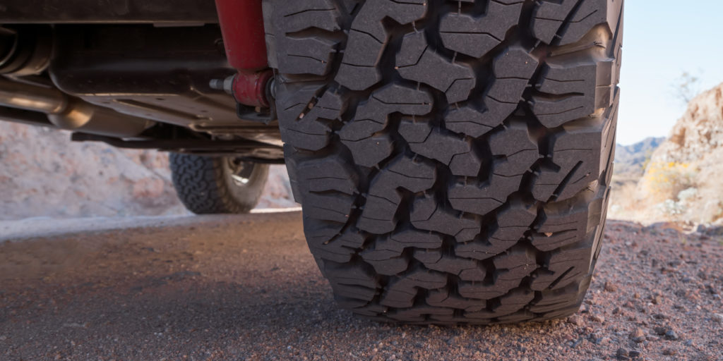 All terrain tires feature huge block grooves for enhanced traction. However, these grooves can make a whole lot of noise!