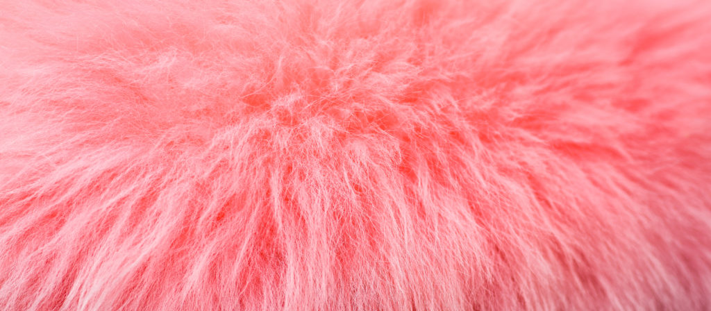 The best fluffy pink car seat covers contain sheepskin for serious warmth during cold winter weather.